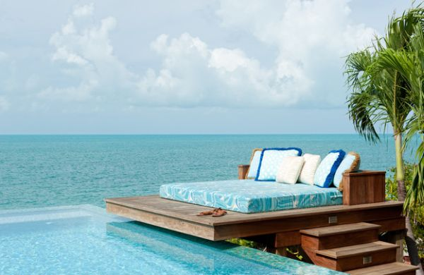 Dream deck space that sports an unexpectedly simple daybed