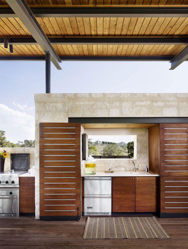Elegant kitchen offers wonderful views of the low rolling hills in the distance