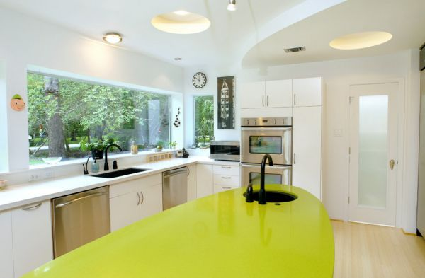 Ergonomic white kitchen with green accents and lovely lighting