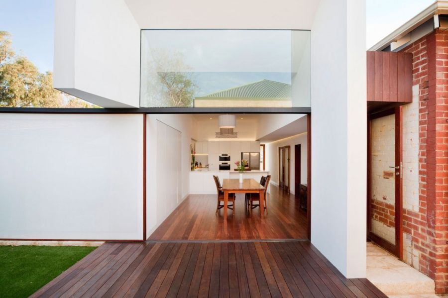 Floor to ceiling glass windows offer visual connectivity