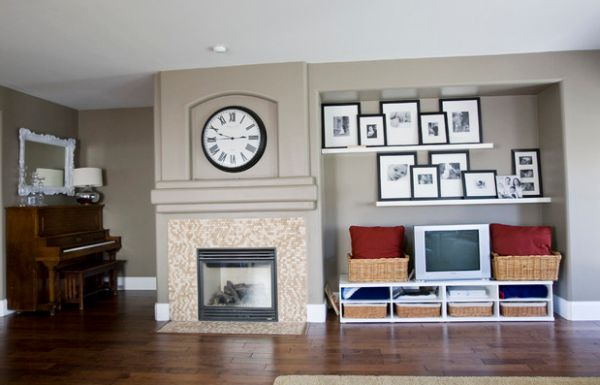 Framed family photos on the floating shelves complement the large wall clock