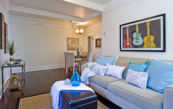 Framed guitar print above the sofa adds color to the space