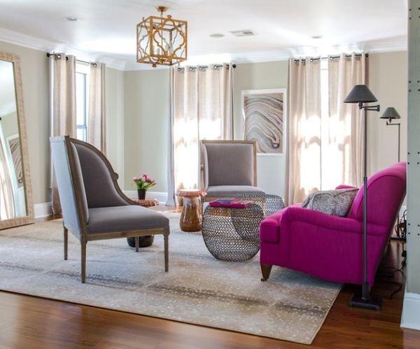 Fuchsia accent couch enlivens the living room in gray