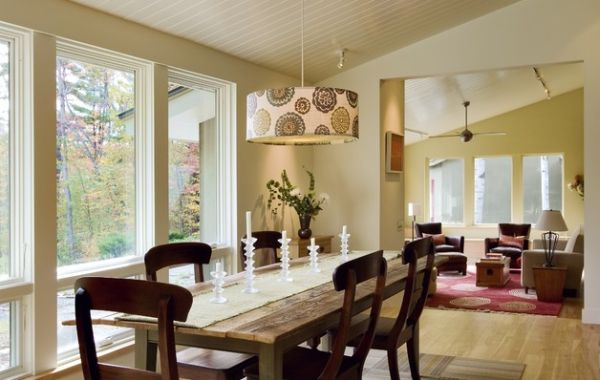 Galbraith and Paul Zinnia Pendant Drum Shade adds visual contrast to the dining area