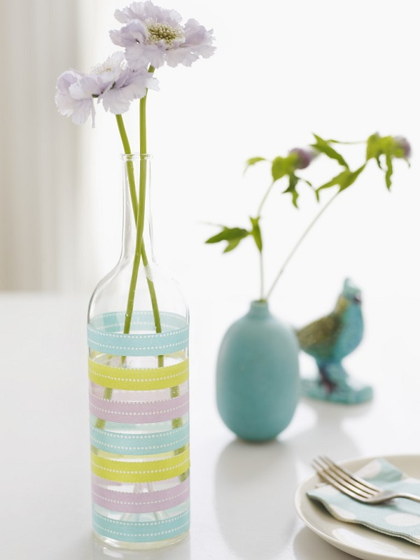 Glass vase with decorative tape stripes