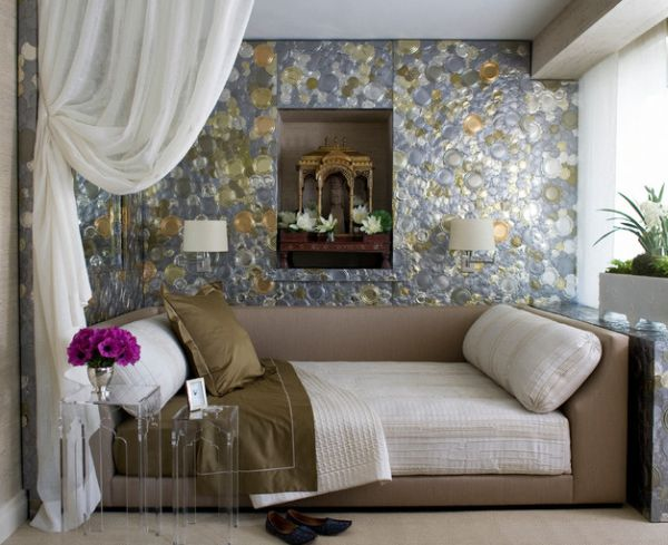 Glittering tin cans wall complements the daybed in neutral hues perfectly