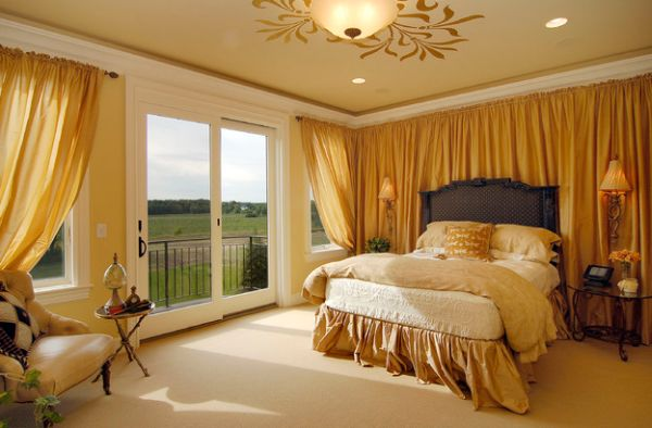 Gold-themed bedroom with sliding glass doors