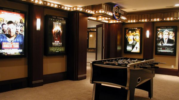 Gorgeous media room entry with illuminated posters – Exquisite!