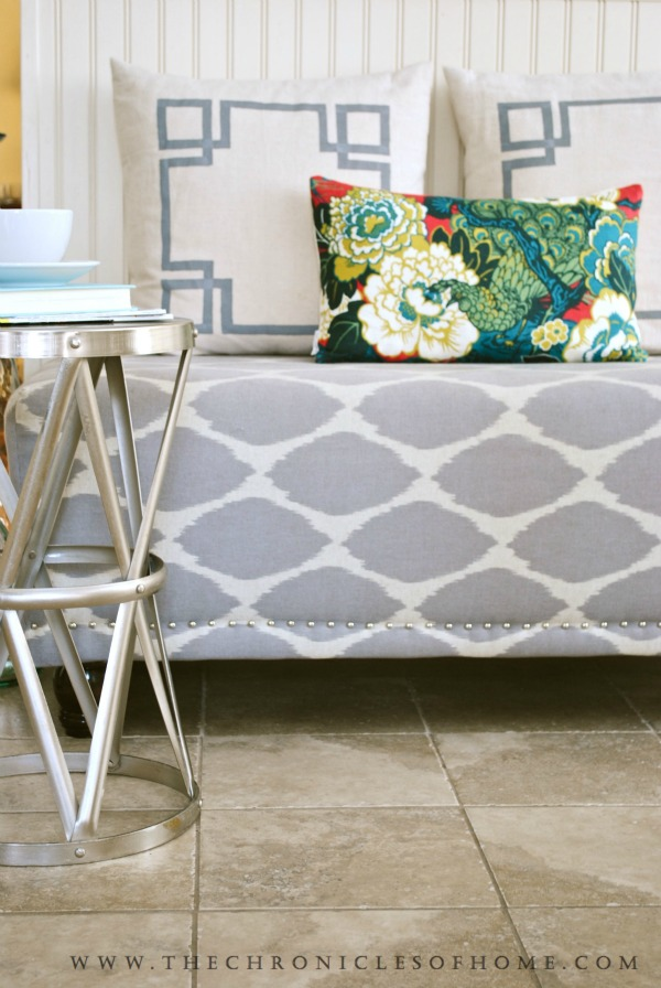 Gray and white upholstered bench with silver nail heads