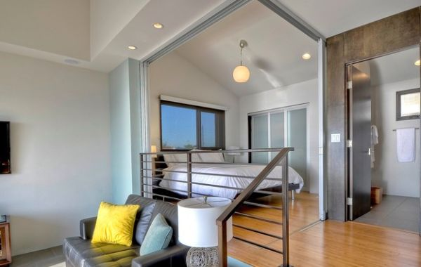 Innovative use of sliding doors to create a bedroom in an open floor plan