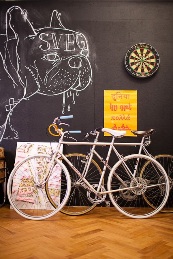Large black board and interesting decor additions make for lively interiors