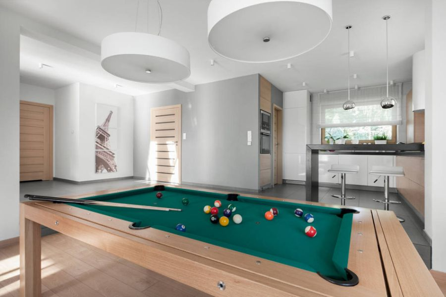 Large white pendants above the pool table