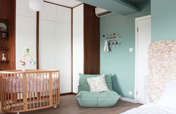 Light blue and white nursery with Togo Fireside chair in matching shade