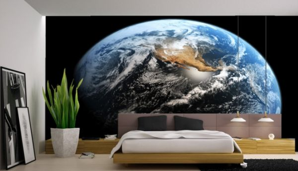 Minimalist bedroom with wall mural depicting a view of earth from space
