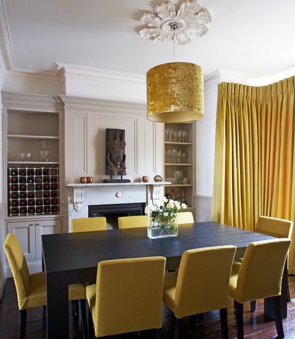 No shortage of golden surfaces in this dining space!