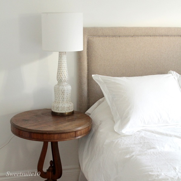 Oatmeal upholstered headboard with silver nailheads