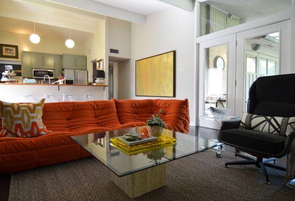 Orange Togo adds sense of playfulness to neutral interiors