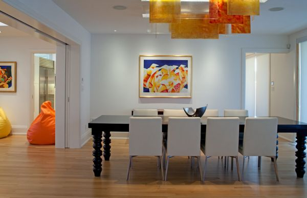 Orange and yellow panels used along with recessed lighting to create unique interiors