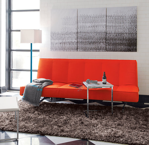 Orange sleeper sofa for compact accommodations