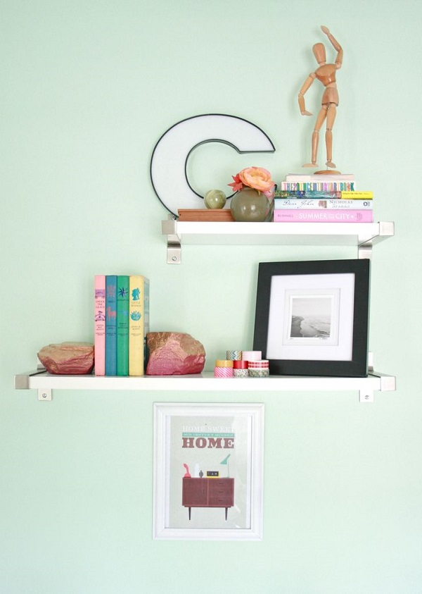 Painted pink and gold rock bookend