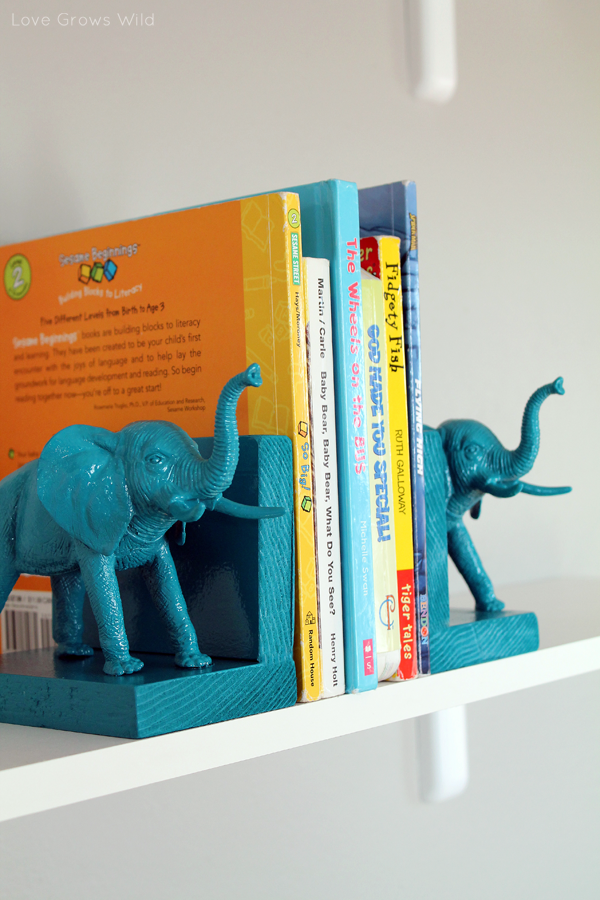 Painted plastic elephants bookend