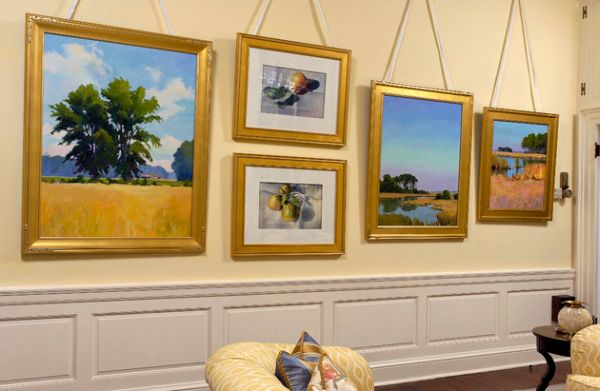 Photo frames with golden hue bring stylish uniformity