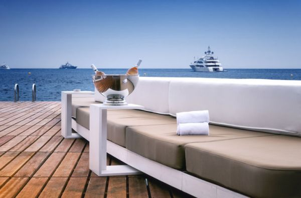 Plush daybeds at the floating beach bar in Monaco