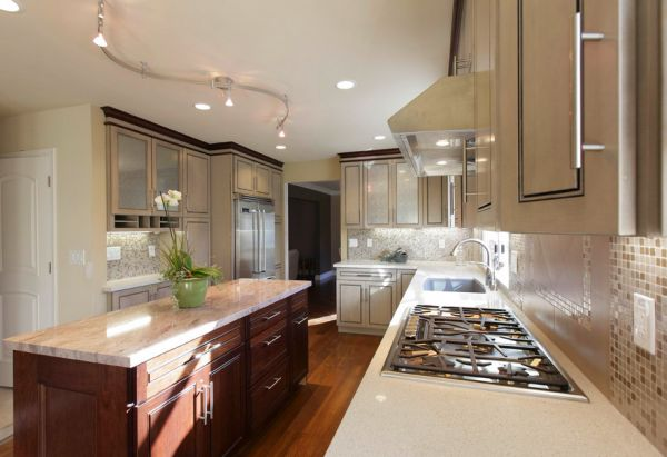 Rail lighting combined with recessed lights in this modern kitchen
