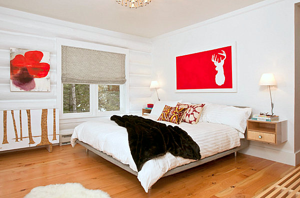 Red accents in a white bedroom