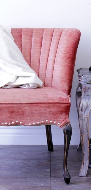 Red upholstered chair with decorative nail heads