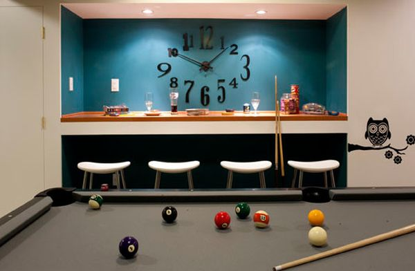Smart recessed lighting highlights the large clock and colorful backdrop perfectly