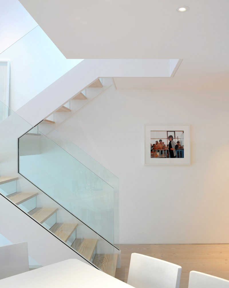 Staircase with glass railing makes an important addition to the Highgate home