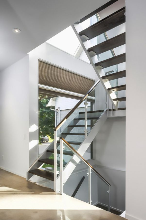 Steel staircase with glass railing in Zen Barn