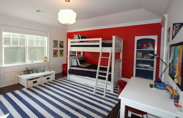Striped carpet and accents of red for a trendy boys' bedroom