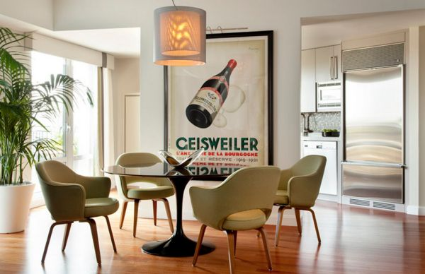 Stylish dining room with an intoxicating poster and Saarinen's design icons