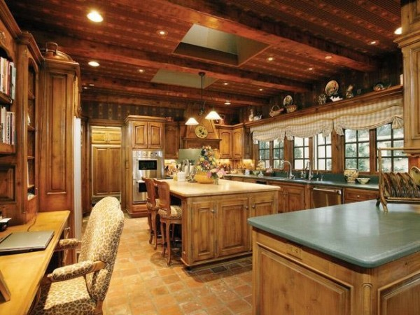Glare from backyard lawn will not bother you when preparing meals in this kitchen