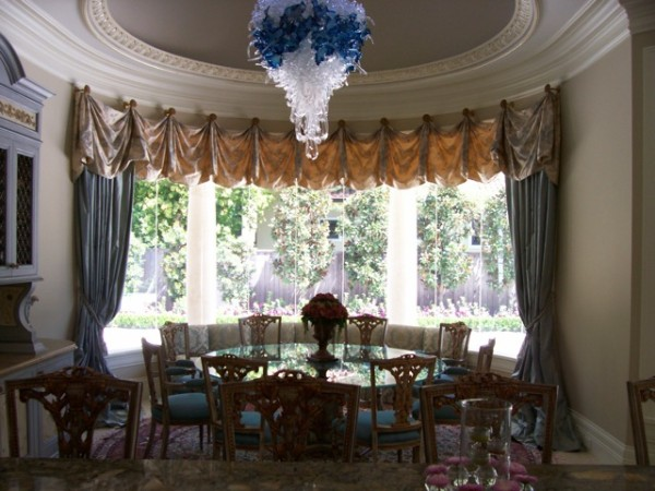Formal dining area with film-protected curved glass