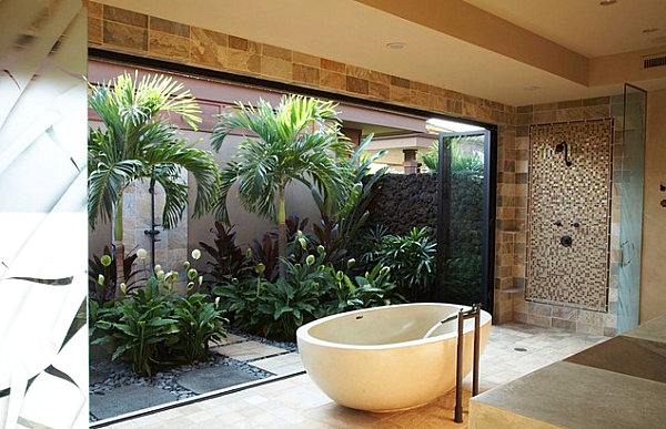 Tropical foliage bring the outdoors into this modern bathroom