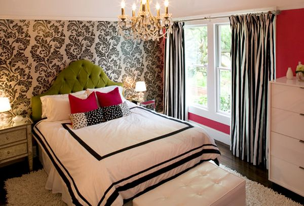 Tufted headboard and bright pillows bring in ample color