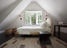 Use scone lighting to save up on leg room in compact bedrooms