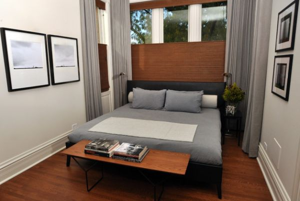 Warm wooden tones combined with soothing gray in a compact bedroom