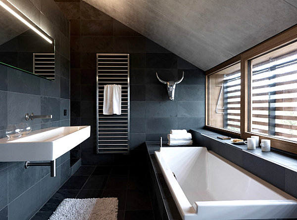 White and metallic details in a dark gray bathroom