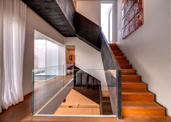 Wooden stairs with steel railing leads to the top level