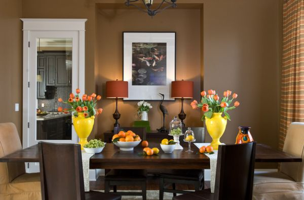 Yellow and orange added to the dining room with plenty of natural flair