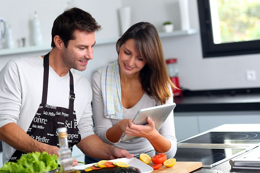 couple in the kitchen using tablet