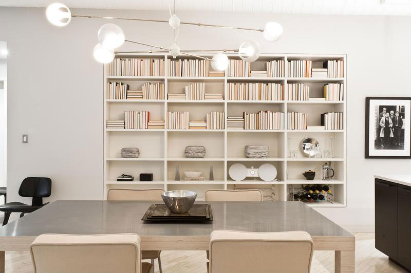 modern dining room with bookcase