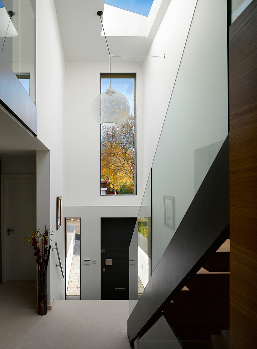 Manchester residence gets a modern makeover encased in warm wooden tones - Home entrance stairs design ...
