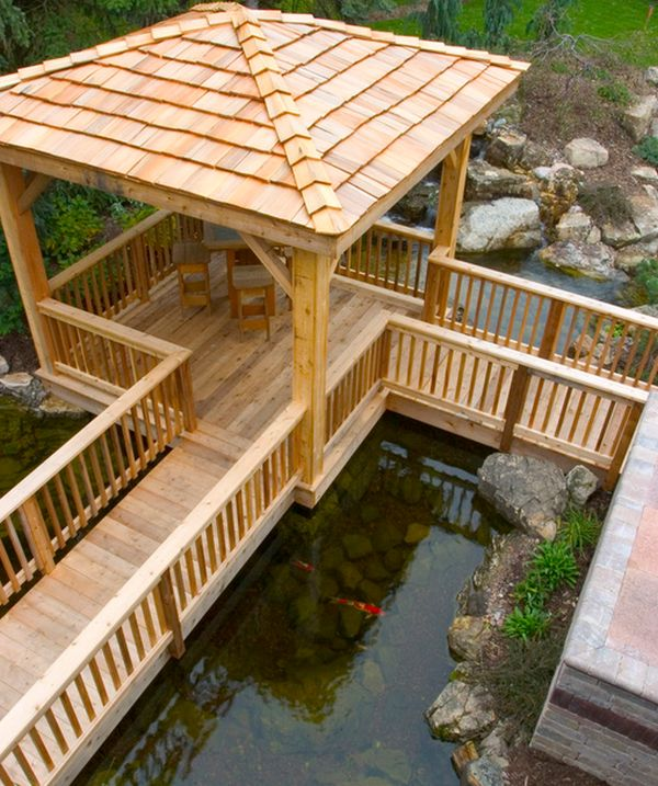Awesome deck space right above the koi pond offers great