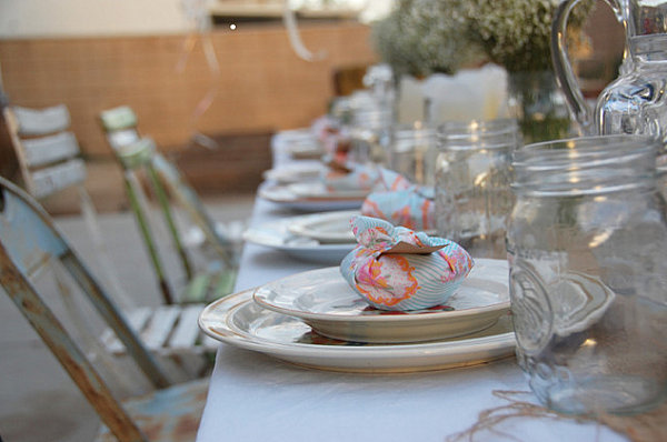 Backyard party table setting with favors