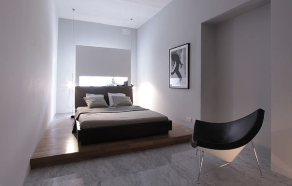 Beautiful minimalist bedroom with the coconut chair